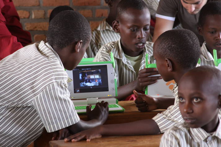 Students at Kicukiro Primary School break out to use XOs (someone needs a power cord!)