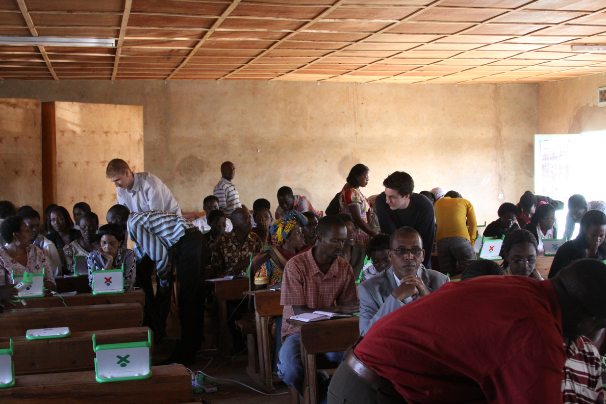 OLPCorps students working with teachers at Kicukiro Primary School (Photo courtesy Michael Stein)